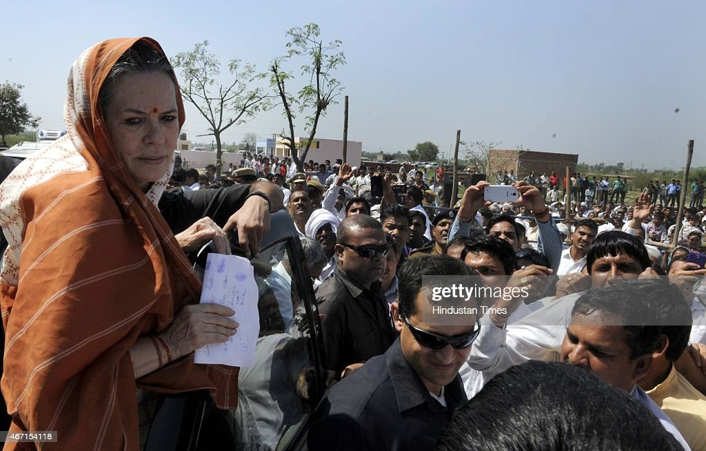 Congress President Sonia Gandhi meets with farmers during her visit at Rattanthal village, Haryana, on March 21, 2015 in Rewari, India. Sonia Gandhi visited several villages in Rohtak district including Gurwara, Surakhpur, Jakkhala Road, Gudiani, Mubarikpur Chowk and Rattanthal. She appealed to the Haryana government to assist the rain-affected farmers whose crops have been destroyed by the recent heavy rainfall in Northern India.