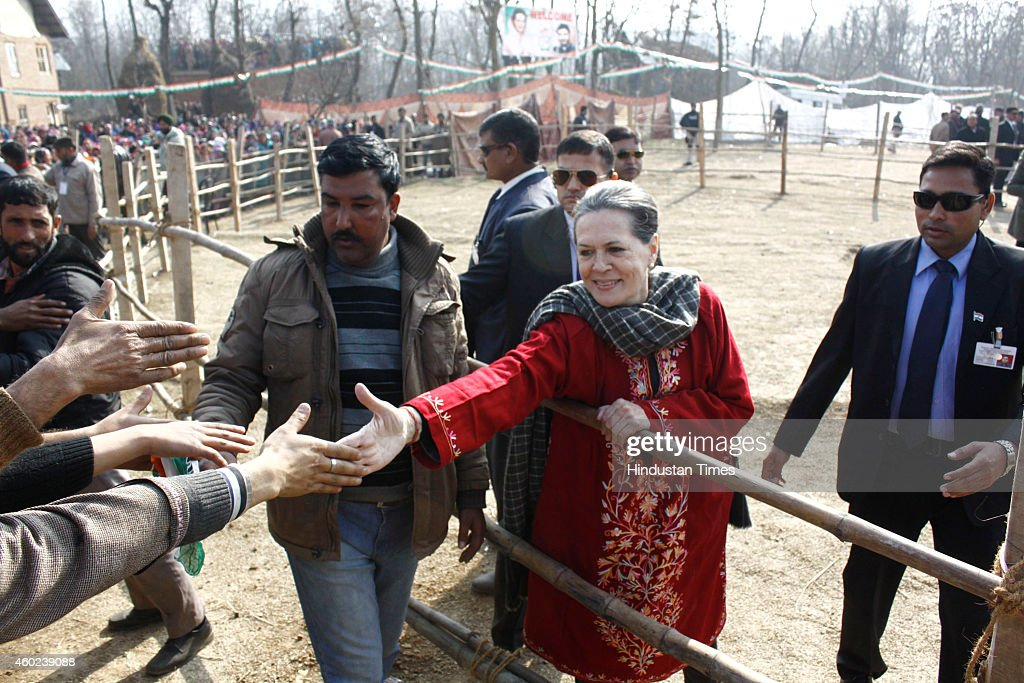 Congress President <a gi-track='captionPersonalityLinkClicked' href=/galleries/search?phrase=Sonia+Gandhi&family=editorial&specificpeople=2287581 ng-click='$event.stopPropagation()'>Sonia Gandhi</a> shaking hands with crowd as she returns after addressing an election rally at Roni Pora Sangus constituency on December 10, 2014 in Anantnag some 75 Kms from Srinagar, India. Congress president said that it was easy to showcase dreams, but the Congress party actually worked for the development of everyone without any kind of bias.
