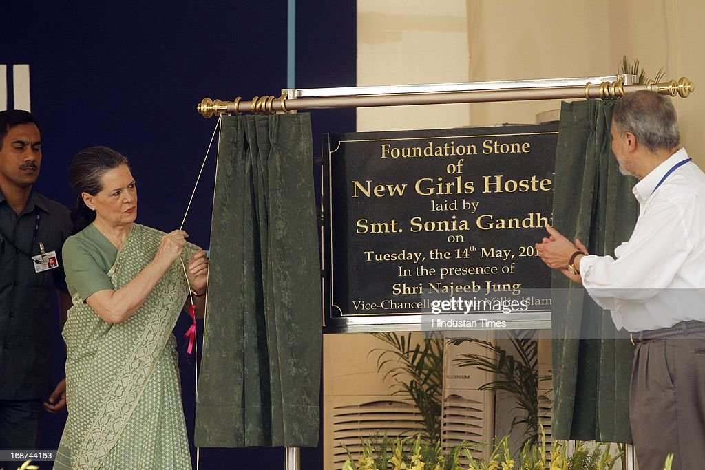 Congress President Sonia Gandhi unveiling a plaque to lay the foundation stone of new girls hostel at Jamia Millia Islamia as Najeeb Jung Vice Chancellor of Jamia Millia Islamia looks on at Jamia Millia Islamia University on May 14, 2013 in New Delhi, India.