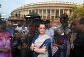 Congress President Sonia Gandhi waits for Vice President Rahul Gandhi and former Prime Minister Manmohan Singh to address the media after a protest...