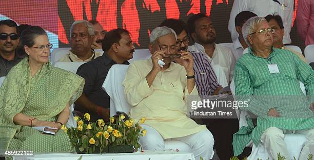 Congress President Sonia Gandhi with Bihar Chief Minister Nitish Kumar and RJD Chief Lalu Prasad during the Swabhiman rally at Gandhi Maidan on...