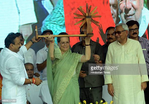 Congress President Sonia Gandhi with Bihar Chief Minister Nitish Kumar during the Swabhiman rally at Gandhi Maidan on August 30 2015 in Patna India...