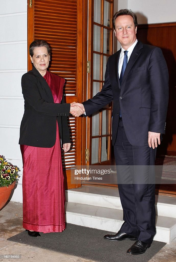 Congress President Sonia Gandhi with British Prime Minister David Cameron, at her residence on February 19, 2013 in New Delhi, India. Cameron, who is here on a three-day visit and heading a biggest ever 100-member delegation, including businessmen has promised full cooperation with Indian investigators probing alleged kickbacks paid to secure Agusta Westland VVIP choppers deal.