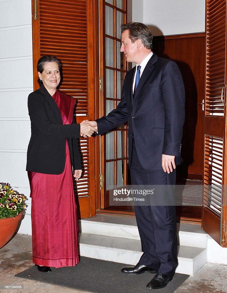 Congress President Sonia Gandhi with British Prime Minister <a gi-track='captionPersonalityLinkClicked' href=/galleries/search?phrase=David+Cameron+-+Politician&family=editorial&specificpeople=227076 ng-click='$event.stopPropagation()'>David Cameron</a>, at her residence on February 19, 2013 in New Delhi, India. Cameron, who is here on a three-day visit and heading a biggest ever 100-member delegation, including businessmen has promised full cooperation with Indian investigators probing alleged kickbacks paid to secure Agusta Westland VVIP choppers deal.