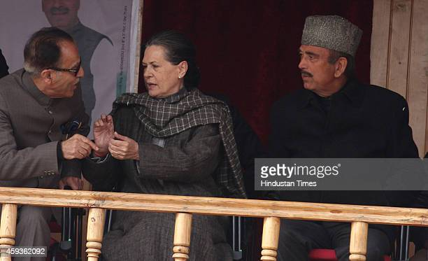 Congress president Sonia Gandhi with Congress leaders Ghulam Nabi Azad and SaifUdDinSoz during an election rally on November 21 2014 in north...