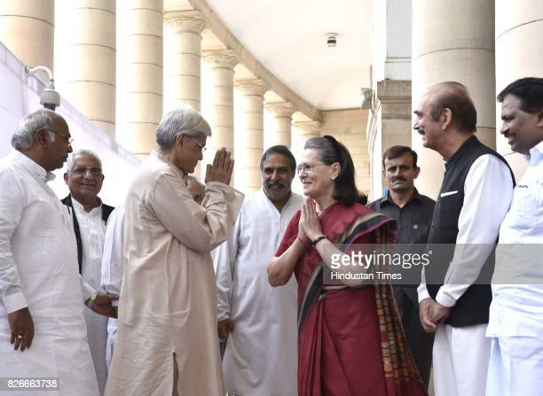 Congress President Sonia Gandhi with UPA vicepresidential candidate Gopal Krishna Gandhi and Mallikarjun Kharge and Ghulam Nabi Azad after casting...