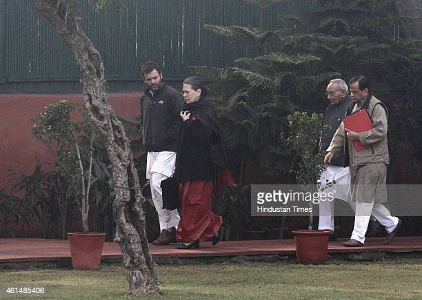 Congress President Sonia Gandhi with Vice President Rahul Gandhi followed by Congress leaders Ahmed Patel and Motilal Vora arrive for CWC meeting at...