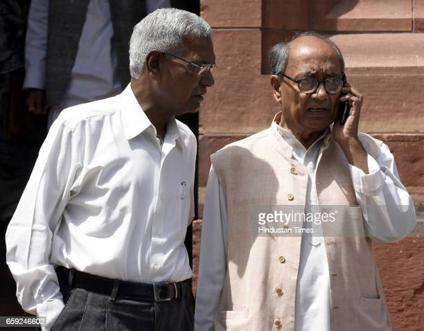 Congress Rajya Sabha MP Digvijaya Singh and CPI MP D Raja during the Parliament Budget Session part2 on March 28 2017 in New Delhi India The...