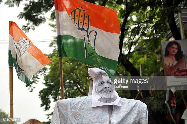 Congress Supporters blocked the road and burning an effigy of Indian Prime Minister Narendra Modi during a protest against 'Congress Vice President...