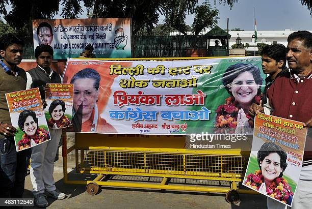 Congress supporters demonstrating outside AICC for their demand induct Priyanka Gandhi to save Congress after party's poor performance in Delhi...
