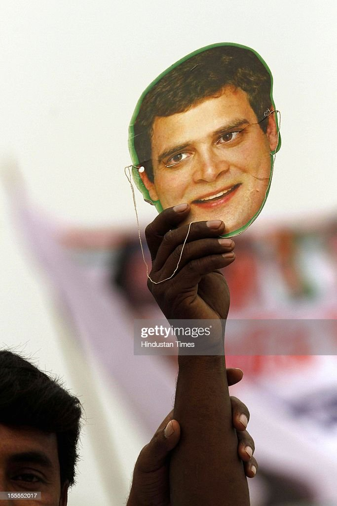 Congress Supporters hold aloft a Rahul Gandhi facemask during the party's Maharally at Ramlila Maidan on November 04, 2012 in New Delhi, India. The rally is expected to set the agenda for the party's one-day brainstorming session at Surajkund on November 9 in which it plans to discuss the current political and economic situation.