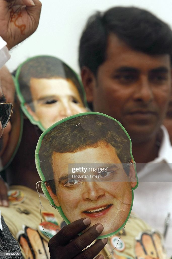 Congress Supporters hold Rahul Gandhi face masks during the party's Maharally at Ramlila Maidan on November 04, 2012 in New Delhi, India. The rally is expected to set the agenda for the party's one-day brainstorming session at Surajkund on November 9 in which it plans to discuss the current political and economic situation.
