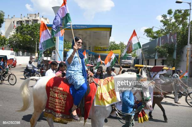 Congress supporters seen on bullock carts holding a protest rally against the hike in fuel prices on September 26 2017 in Jaipur India