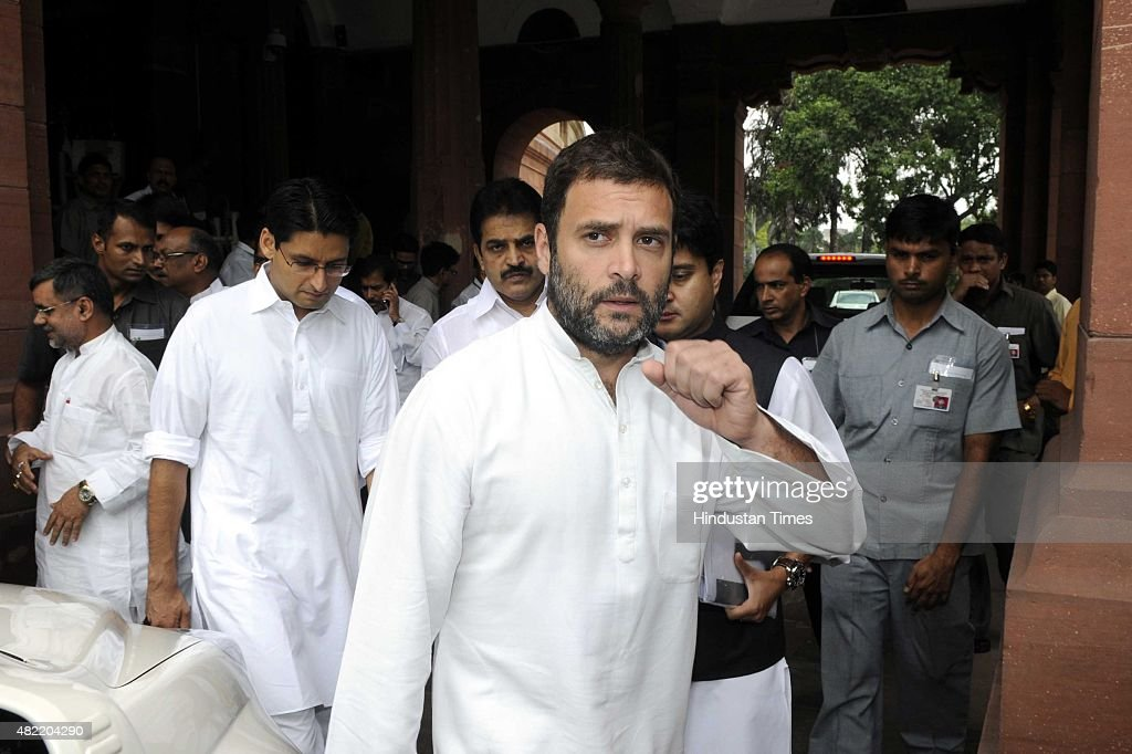 Congress Vice President and Lok Sabha Member of Parliament, <a gi-track='captionPersonalityLinkClicked' href=/galleries/search?phrase=Rahul+Gandhi&family=editorial&specificpeople=171802 ng-click='$event.stopPropagation()'>Rahul Gandhi</a> and other party MPs leave after expressing their condolences at the demise of former President of Indian, APJ Abdul Kalam during the ongoing Monsoon Session at the Parliament House, on July 28, 2015 in New Delhi, India. As a mark of respect to the departed former President A.P.J. Abdul Kalam, members of both Houses stood in silence before the proceedings were adjourned for the day. Both Houses were adjourned till July 30.