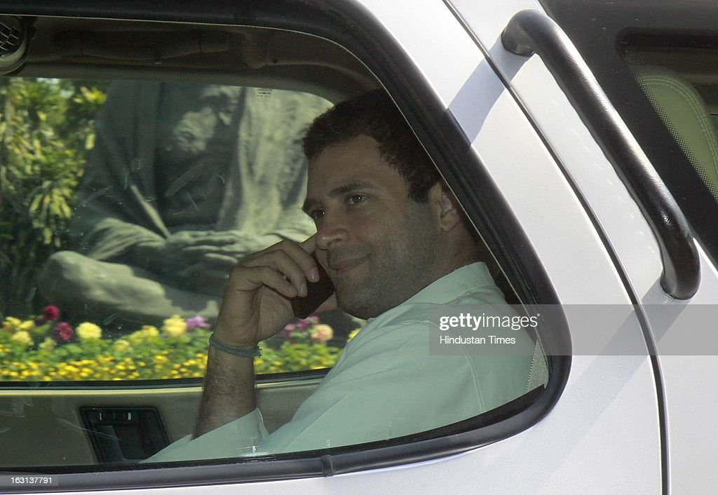 Congress Vice President and member of parliament Rahul Gandhi arrive on the car talking with mobile phone attending ongoing parliament budget session on March 5, 2013 in New Delhi, India. Both houses of Parliament were adjourned till noon after opposition parties raised various issues including the killing of a police officer in Uttar Pradesh.