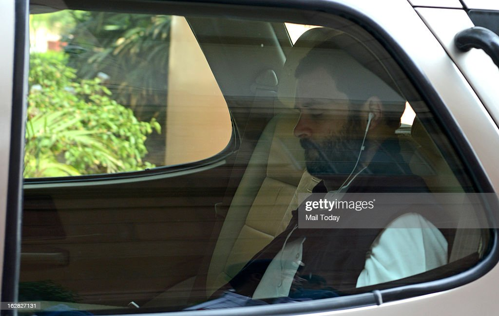 Congress Vice President and MP Rahul Gandhi listening music as he arrives at Parliament house during the ongoing budget session at Parliament House on Wednesday.