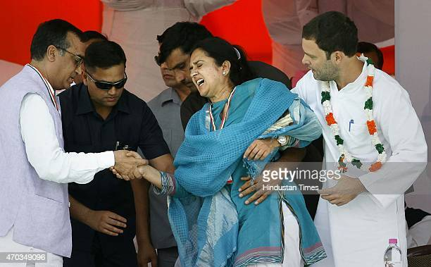 Congress Vice President Rahul Gandhi and leader Ajay Makan supports Haryana Congress leader Kiran Choudhary after she stumbled on the stage during...