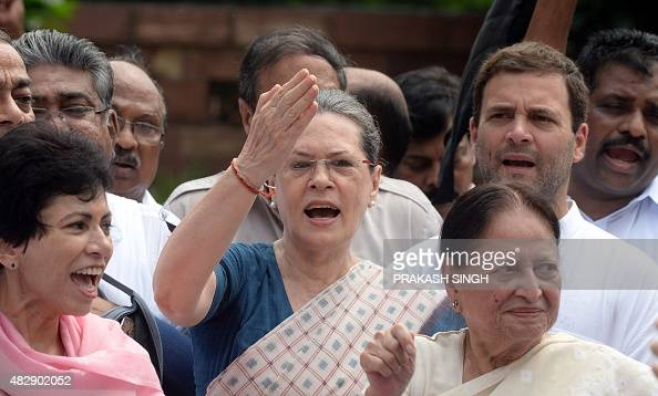 Congress Vice President Rahul Gandhi and President Sonia Gandhi shout slogans during a protest by Congress Party Members of Parliament at the Mahatma...