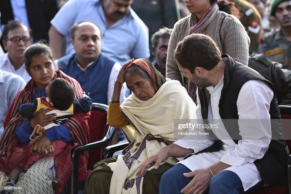 Congress Vice President Rahul Gandhi consoles family members of the rescued soldier Lance Naik Hanumanthappa during his funeral ceremony at Brar square crematorium on February 11, 2016 in New Delhi, India. Lance Naik Hanamanthappa Koppad of 19 Madras Regiment was rescued alive on night after being buried under 35 feet of snow for six days. The lone survivor of the February 3 Siachen avalanche that claimed the lives of nine soldiers, breathed his last at the Army RR Hospital in Delhi.