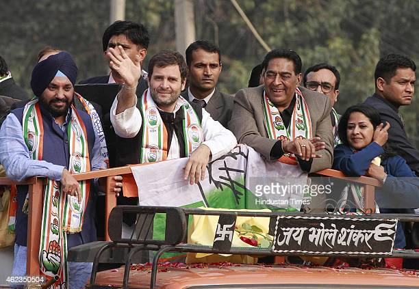 Congress Vice President Rahul Gandhi DPPC president Arvinder Singh Lovely and other party leaders during a roadshow at Kalkaji Extention ahead of the...