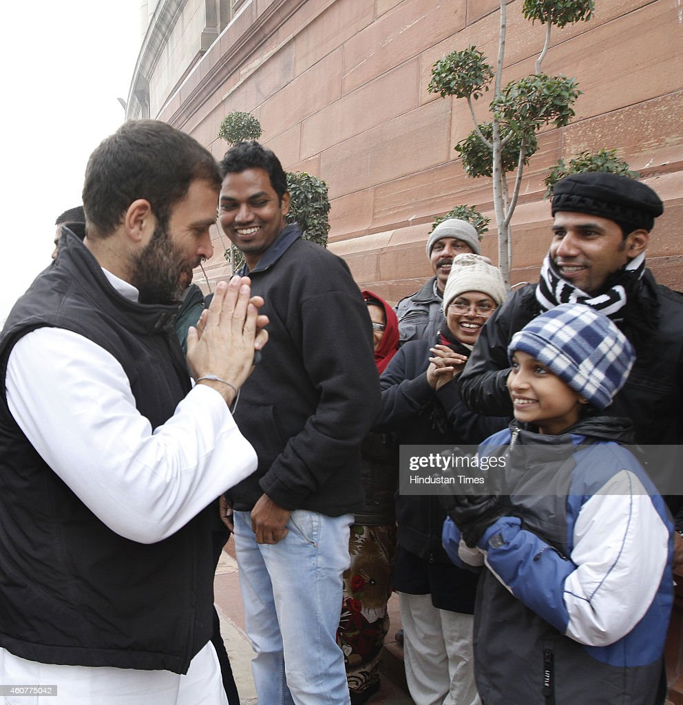 Congress Vice President <a gi-track='captionPersonalityLinkClicked' href=/galleries/search?phrase=Rahul+Gandhi&family=editorial&specificpeople=171802 ng-click='$event.stopPropagation()'>Rahul Gandhi</a> greets visitors at the Parliament House complex on December 22, 2014 in New Delhi, India. The conversion heat, which has been paralysing Rajya Sabha since last week, today reached the Lok Sabha with opposition trying to corner the government which asserted that neither it nor BJP has anything to do with conversions.