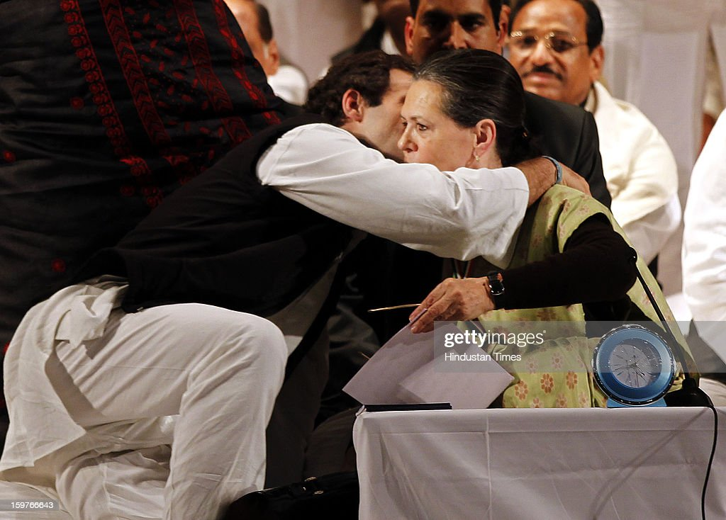 Congress Vice President Rahul Gandhi hugs his mother and congress President Sonia Gandhi during the AICC meeting after the two days 'Chintan Shivir' at Birla Auditorium, Jaipur on January 20, 2013 in Rajasthan, India.