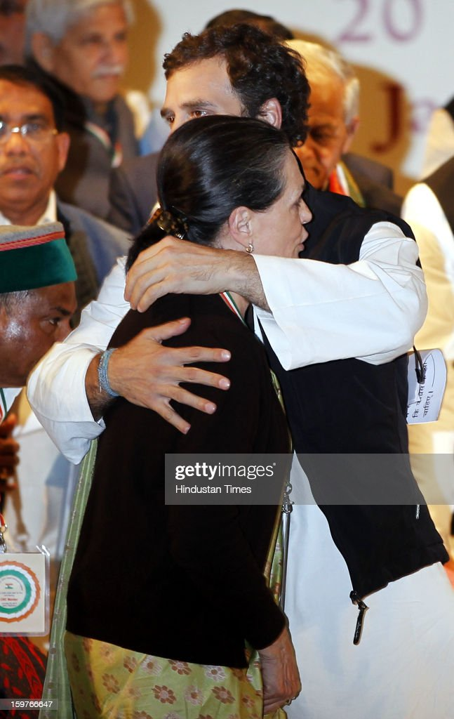Congress Vice President Rahul Gandhi hugs his mother Congress President Sonia Gandhi during the AICC meeting after the two days 'Chintan Shivir' at Birla Auditorium, Jaipur on January 20, 2013 in Rajasthan, India.