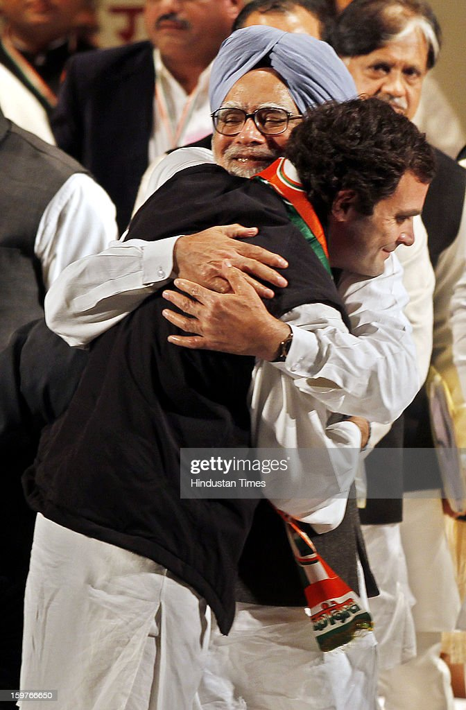 Congress Vice President Rahul Gandhi hugs Prime Minister Manmohan Singh during the AICC meeting after the two days 'Chintan Shivir' at Birla Auditorium, Jaipur on January 20, 2013 in Rajasthan, India.