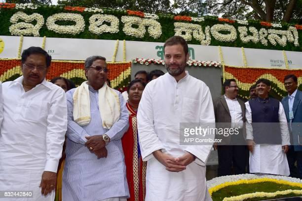 Congress Vice President Rahul Gandhi Karnataka Chief Minister Siddaramaiah and state ministers G Parameshwara and DK Shivakumar attend the opening of...
