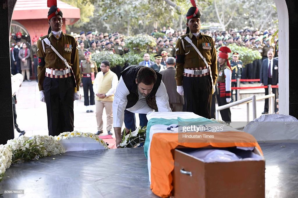 Congress Vice President Rahul Gandhi paying his last respect to the rescued soldier Lance Naik Hanumanthappa during his funeral ceremony at Brar square crematorium on February 11, 2016 in New Delhi, India. Lance Naik Hanamanthappa Koppad of 19 Madras Regiment was rescued alive on night after being buried under 35 feet of snow for six days. The lone survivor of the February 3 Siachen avalanche that claimed the lives of nine soldiers, breathed his last at the Army RR Hospital in Delhi.