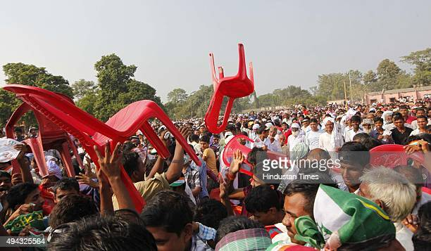 Congress Vice President Rahul Gandhi salutes the party workers during an election rally amid the ongoing Bihar Assembly polls at Areraj on October 26...