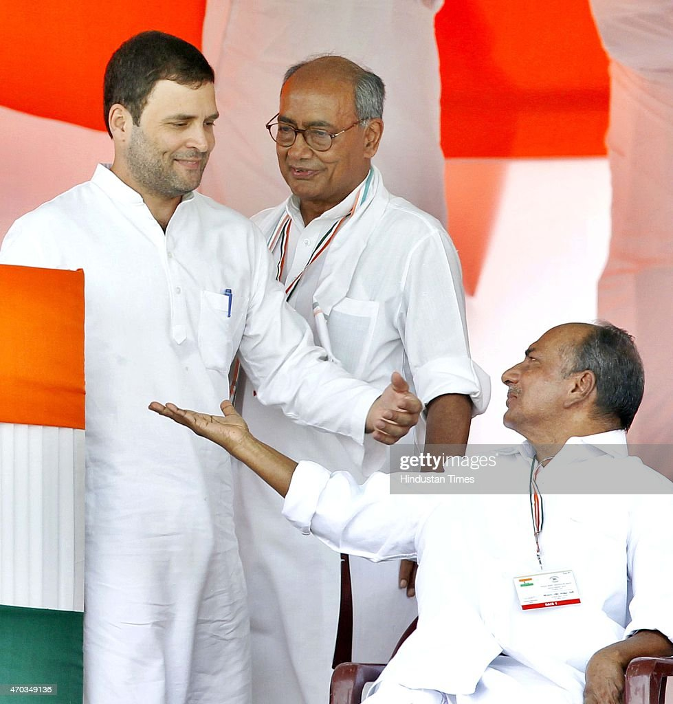 Congress Vice President <a gi-track='captionPersonalityLinkClicked' href=/galleries/search?phrase=Rahul+Gandhi&family=editorial&specificpeople=171802 ng-click='$event.stopPropagation()'>Rahul Gandhi</a>, Senior leaders AK Antony and Digvijay Singh during the farmers rally (Kisan-Khet Mazdoor Rally) to galvanise protests against National Democratic Alliance's (NDA) land acquisition law at Ramlila Maidan on April 19, 2015 in New Delhi, India. Druing a rally, <a gi-track='captionPersonalityLinkClicked' href=/galleries/search?phrase=Rahul+Gandhi&family=editorial&specificpeople=171802 ng-click='$event.stopPropagation()'>Rahul Gandhi</a> said, 'I tell you how Modi ji won the election. He took loans of thousands of crores from big industrialists from which his marketing was done. How will he pay back that loan now? He will do it by giving your land to those top industrialists. He wants to weaken the farmers, then snatch their land and give it to his industrialist friends.' Sonia Gandhi said that the voice of India's farming community can never be silenced or suppressed, and any attempt to do so, would be countered with all the power at her command. She accused the Modi government of adding insult to the injury of farmers by bringing the land ordinance.