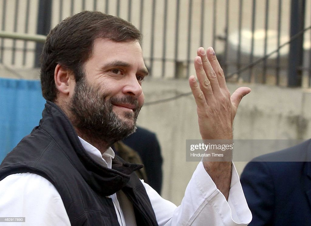 Congress vice president <a gi-track='captionPersonalityLinkClicked' href=/galleries/search?phrase=Rahul+Gandhi&family=editorial&specificpeople=171802 ng-click='$event.stopPropagation()'>Rahul Gandhi</a> shows his ink-marked finger after casting his vote at a polling station during the Delhi Assembly Elections 2015, at Aurangjeb Lane on February 7, 2015 in New Delhi, India. Delhi is headed for a record turnout on Saturday as more than 69.5% of the city's 1.33 crore voters cast their ballot till 5pm. After a slow start in the morning, polling picked up around noon, with scores of people queuing up at booths to exercise their franchise in an electrifying electoral battle that the national capital has never witnessed before. 69.5 per cent of 1.3 voters had been inked by 5 pm on Saturday, as Delhi looked set for a record turnout after a slow morning. There are 673 candidates in the fray now. Voting is taking place in 11,763 centers, located in schools. Many initial voters in middle class and posh areas were early morning walkers.