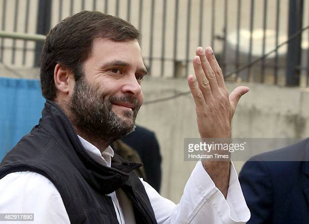 Congress vice president Rahul Gandhi shows his inkmarked finger after casting his vote at a polling station during the Delhi Assembly Elections 2015...