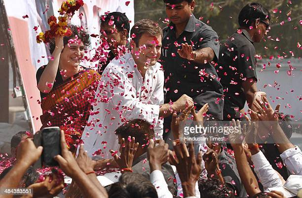 Congress vice president Rahul Gandhi waves to the supporters with his sister Priyanka Vadra as he arrives to file his nomination for the ongoing Lok...