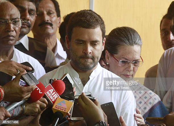 Congress Vice President Rahul Gandhi with Congress President Sonia Gandhi addressing the media after protest against the suspension of their 25...