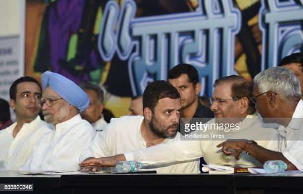 Congress Vice President Rahul Gandhi with former Prime Minister Manmohan Singh Left party leader D Raja during 'Sajhi Birasat Bachao Sammelan' called...