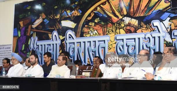 Congress Vice President Rahul Gandhi with former Prime Minister Manmohan Singh Left party leader D Raja and NCP leader Tariq Anwar during 'Sajhi...