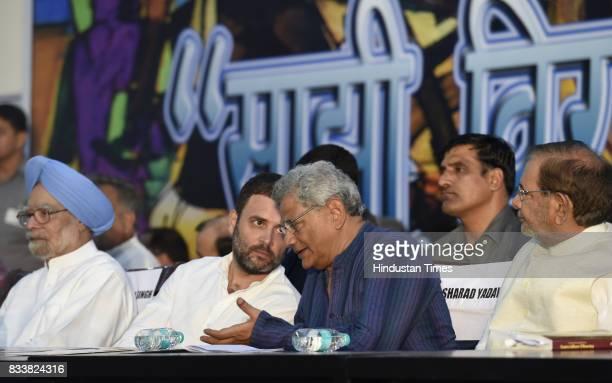 Congress Vice President Rahul Gandhi with former Prime Minister Manmohan Singh Left party leader Sitaram Yechury during 'Sajhi Birasat Bachao...