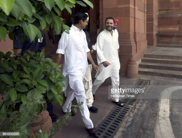 Congress Vice President Rahul Gandhi with other MPs leaves attending the Parliament Budget Session on April 5 2017 in New Delhi India Employees...