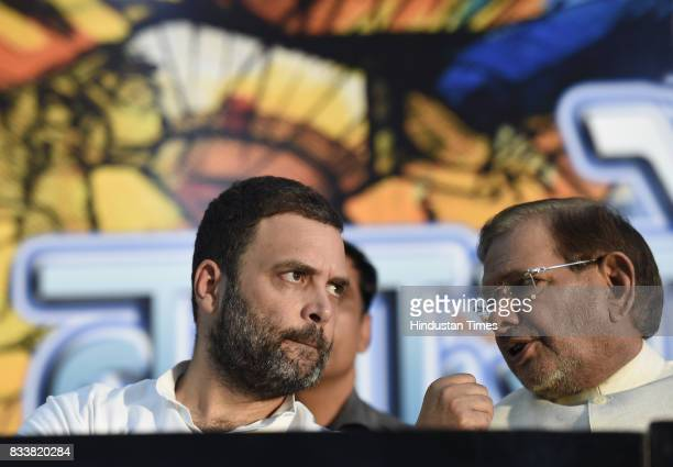 Congress Vice President Rahul Gandhi with Sharad Yadav during 'Sajhi Birasat Bachao Sammelan' called by JD leader Sharad Yadav at Constitution Club...