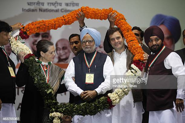 Congress VicePresident Rahul Gandhi Prime Minister Manmohan Singh and Congress President Sonia Gandhi receive a garland from their party workers...