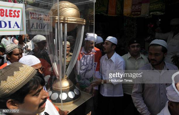 Congress Workers carry world cup replica to get blessing of Mahim's Makdoom Shah Dargah Mahim Church and Gurudwara for Team India's Victory in World...