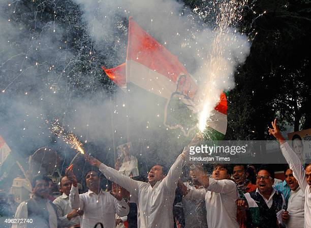 Congress workers celebrate after Mahagathbandhan's victory in Bihar assembly elections at AICC on November 8 2015 in New Delhi India Nitish Kumar...