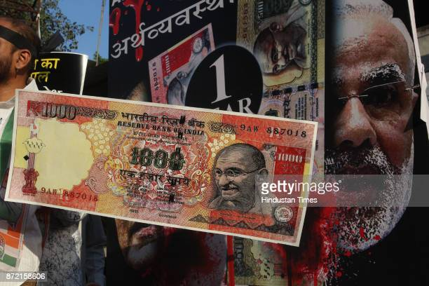 Congress workers protest against one year completion of Demonetisation and BJP Govt outside Mulund Railway Station on November 7 2017 in Mumbai India...