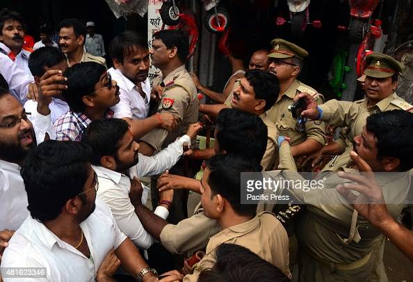 Congress workers tussle with the policemen during the nationwide protest against Prime Minister Narendra Modi
