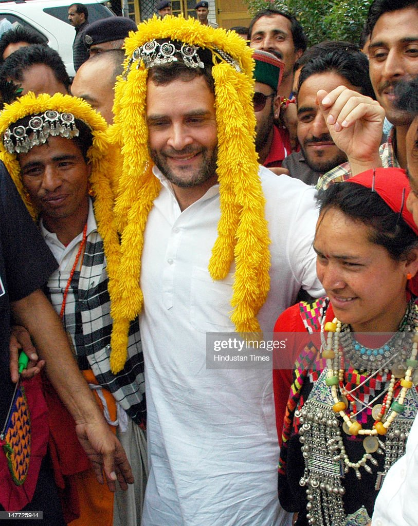 Congress workers welcome AICC General Secretary Rahul Gandhi as he comes out after attending the meeting of party's office bearers, MLAs, MPs, AICC members, different party committees on June 2, 2012 in Kullu, India. AICC has appointed observers for the upcoming polls in four parliamentary constituencies and in each of the districts to oversee the poll arrangements and campaigning.