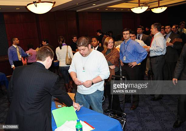 Congressinal staff members line up to pick up invitations and tickets to the presidential inauguration on January 12 2009 at the Capitol in...