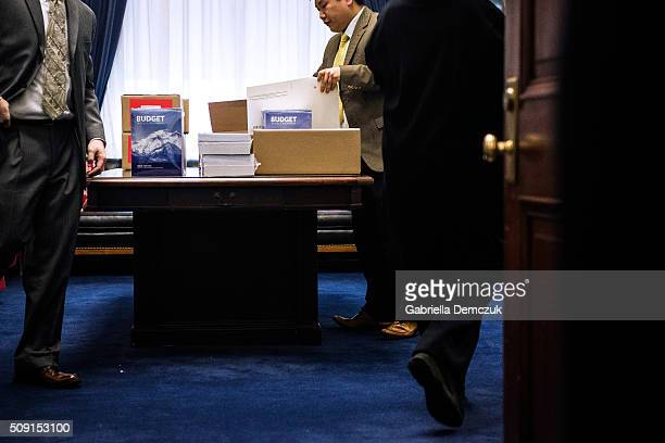 Congressional aids deliver boxes of the President's Fiscal Year 2017 Budget to the House Budget Committee Room in the Cannon House Office Building on...
