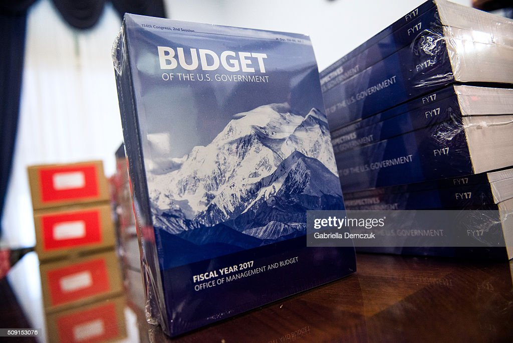 Congressional aids unpack boxes of the President's Fiscal Year 2017 Budget to the House Budget Committee Room in the Cannon House Office Building on...